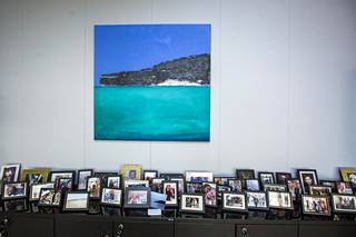 Dozens of family pictures on side table in Vestager's office.