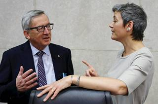 Commission President Jean-Claude Juncker and Margrethe Vestager discussing in April 2015.