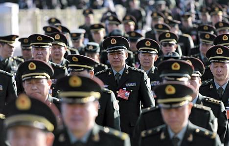 Kiinan armeijan edustajat osallistuivat Mahtavan kansan salissa pidettävään Kiinan kansankogressin täysistuntoon Pekingissä tiistaina.