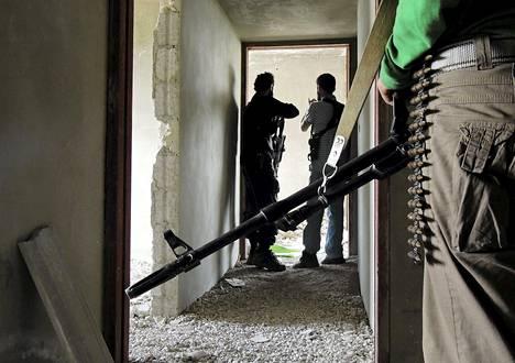 Hallituksen vastaisia taistelijoita Mlehan esikaupungissa Damaskosissa toukokuun lopulla. Kevääseen 2014 mennessä Syyriassa on taistellut arviolta 12 000 ulkomaista taistelijaa.