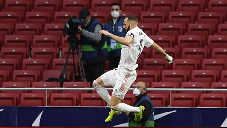 Real Madridin Karim Benzema juhli tasoitusmaalia varsinaisen peliajan lopulla.