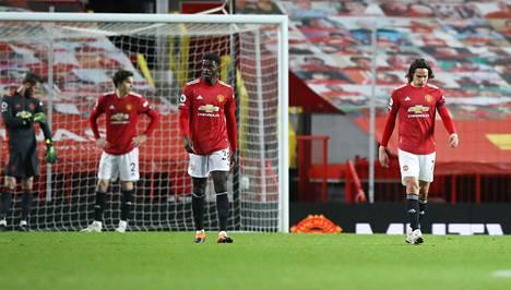 Manchester Unitedin Axel Tuanzebe (kolmas vas.) ja muut Unitedin pelaajat joutuivat pettymään, kun Evertonin Dominic Calvert-Lewin tasoitti ottelun aivan viime hetkillä.