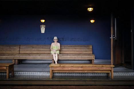 Ms. Ritva Ohmeroluoma was photographed cooling off on the outdoor terrace of the Finnish Sauna Association in Lauttasaari, Helsinki.