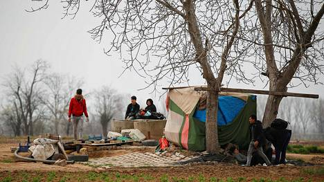 Migrants rest near Turkeys Pazarkule border crossing with Greeces Kastanies, in Edirne, Turkey March 9, 2020.