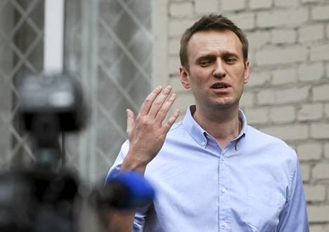 Oppositiojohtaja Alexei Navalny puhui tiedotusvälineille Moskovassa tiistaina,.