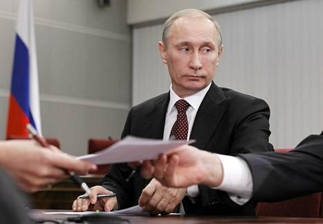 Pääministeri Vladimir Putin kävi rekisteröitymässä presidenttiehdokkaaksi Moskovassa keskiviikkona.