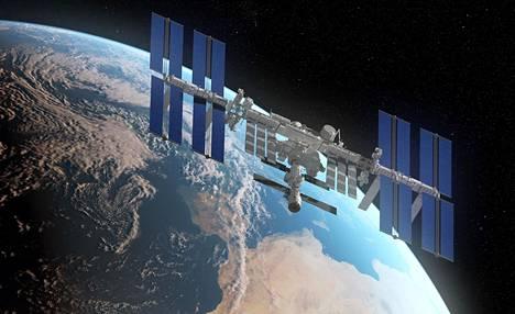 Tietokoneella laadittu havainnekuva Kansainvälisestä avaruusasemasta ja Maasta.