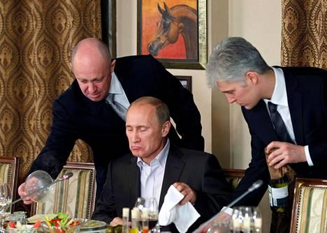 "Called ""Putin's Chef,"" Yevgeny Prigozini (left) served President Vladimir Putin at the Cheval Blanc Restaurant near Moscow in 2011."