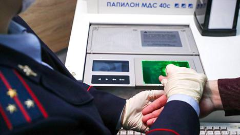 MOSCOW, RUSSIA - FEBRUARY 18, 2021: An officer of a transit police unit of the Russian Interior Ministry takes a person's fingerprints at Vnukovo International Airport. February 18 is the professional holiday of employees of Russias law enforcement agencies serving at railway, air, and water transportation facilities. Anton Novoderezhkin/TASS (Photo by Anton Novoderezhkin\TASS via Getty Images)