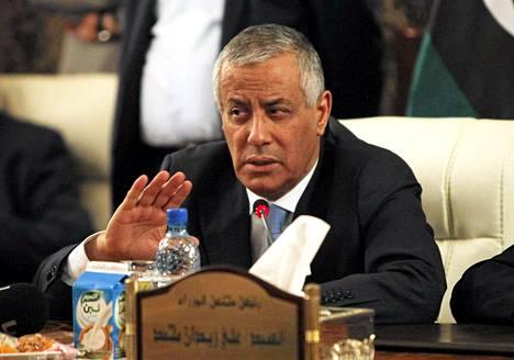 Libyan pääministeri Ali Zidan piti tiedotustilaisuuden hallituksen päämajassa Tripolissa torstaina sen jälkeen, kun asemiehet olivat vapauttaneet hänet.