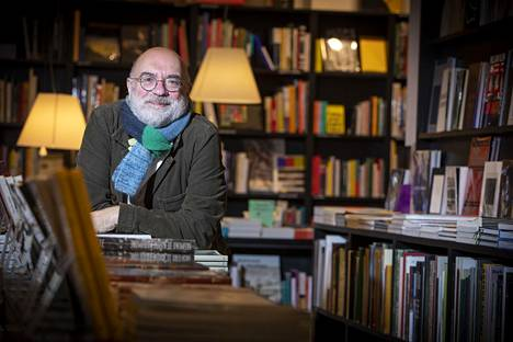 Philippe Demoulin has been allowed to keep the art bookstore Peinture Fraîchen open while many others close their doors.