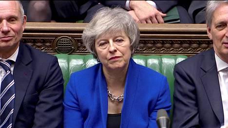 Pääministeri Theresa May kuunteli parlamentin keskustelua keskiviikkona.