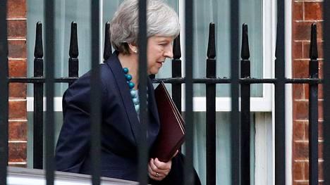 Pääministeri Theresa May vakuuttaa, että Britannia eroaa EU:sta 29. maaliskuuta.