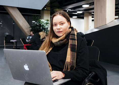 """Hanna-Mari Ylinen often studies at the Central Library in Oodi.  """"The spouse works remotely at home, so it makes it a little harder to study at home,"""" Ylinen says."""