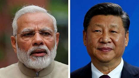 Intian pääministerin Narendra Modi(vas.) ja Kiinan johtaja Xi Jinping