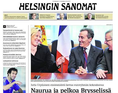 Jutta Urpilaisen Jean-Claude Junckerille (oik.) antama kuva julkaistiin Helsingin Sanomissa 12. heinäkuuta 2011.