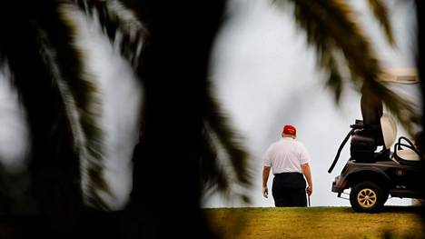 U.S. President Donald Trump plays golf at the Trump International Golf Club in West Palm Beach, Florida, U.S., December 30, 2020. REUTERS/Marco Bello