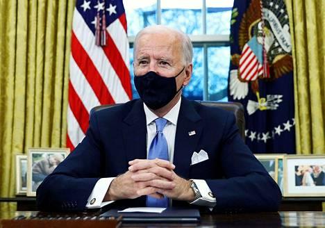 Presidentti Joe Biden Valkoisessa talossa keskiviikkona 20. tammikuuta 2021.