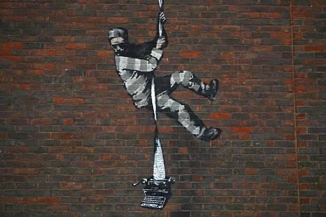Katutaiteilija Banksyn tuorein työ esittää vankilasta pakenevaa vankia.
