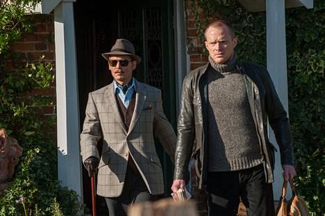 Johnny Depp (vas.) ja Paul Bettany näyttelevät Mortdecai-komediassa.