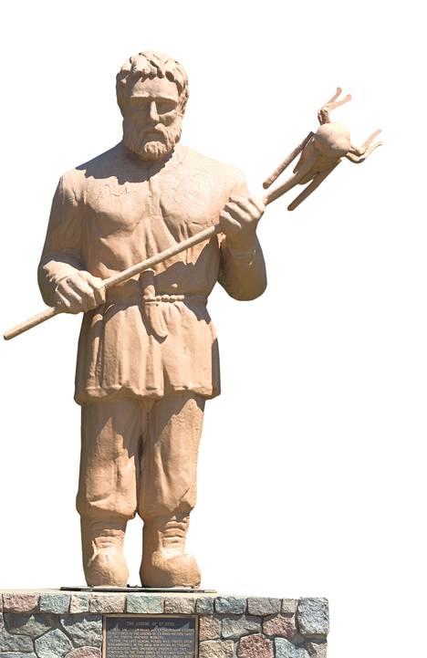 Heinäsirkkaa pitelevä Pyhä Urho seisoo Menahgan kaupungissa Minnesotassa.