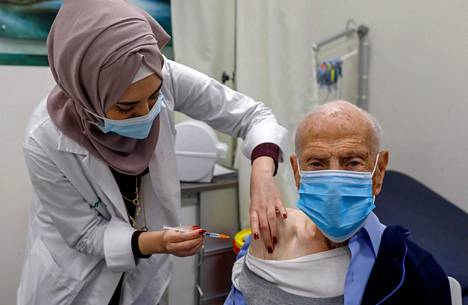 A Palestinian man was vaccinated on January 7 in the Israeli-administered suburb of Beit Hanina in East Jerusalem.