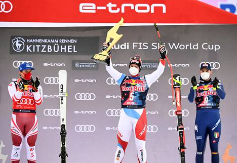 The best of the Kitzbühel plunge race reached the podium, although the race was suspended due to strong winds.  Switzerland's Beat Feuz (center) fell to victory ahead of Austria's Matthias Mayer (left) and Italy's Dominik Paris.