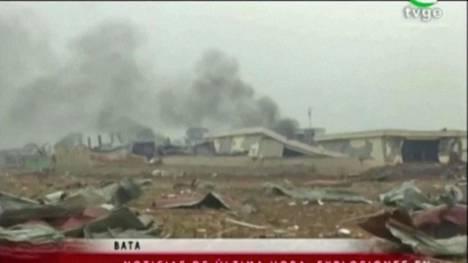 Paikallisen tv-kanavan TVGE:n välittämässä kuvassa näkyy savuavia rakennuksia.