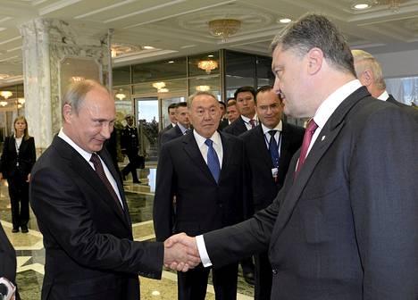 Vladimir Putin ja Petro Poroshenko tapasivat Minskissä elokuussa.