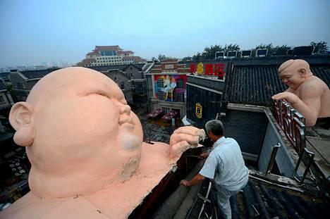 Patsaita tuhottiin Shandongin maakunnassa Kiinassa perjantaina.