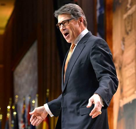 Texasin kuvernööri Rick Perry tervehti tuhansia konferenssivieraita saapuessaan CPAC-kokoukseen perjantaina.