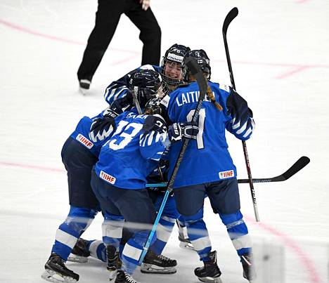 Finnish team celebrating Elisa Holopainen's goal at the World Championships.  Nelli Laitinen, who will play in the finals with Holopainen, will also be airing (number 7).