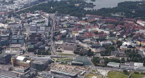 Eduskuntatalo (kuvassa keskellä) sijaitsee Etu-Töölön kaupunginosassa Helsingissä. Töölössä on niukahkosti kansanedustajien kakkosasunnoiksi kaipaamia pieniä asuntoja.