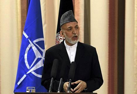 Presidentti Hamid Karzai puhui tiistaina seremoniassa, jossa vastuu Afganistanin turvallisuudesta siirtyi maan omalle armeijalle.