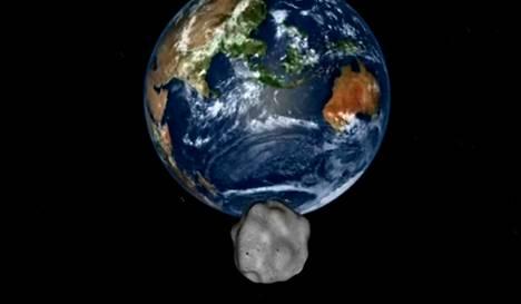 Taiteilijan näkemys asteroidista lähestymässä Maata.