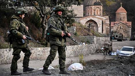 A Russian peacekeeper patrol in front of the 12th-13th century Orthodox Dadivank Monastery, outside the town of Kalbajar on November 15, 2020, after the peacekeepers placed it under their protection during the military conflict between Armenia and Azerbaijan over the breakaway region of Nagorno-Karabakh. - Kalbajar is one of the seven districts which will be transferred to Azerbaijan as part of a deal on Nagorno-Karabakh. LEHTIKUVA / AFP