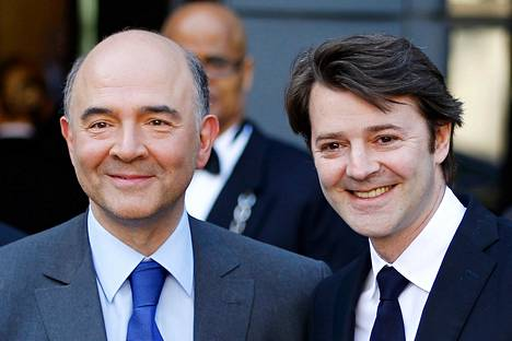 Pierre Moscovici (vas.) ja François Baroin