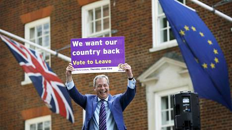 Leader of the United Kingdom Independence Party Nigel Farage holds a placard as he launches his party's EU referendum tour bus in London,
