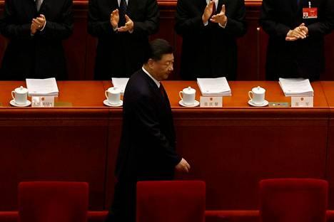 Kiinan presidentti ja kommunistipuolueen johtaja Xi Jinping saapui kansankongressin vuosittaisen istunnon avajaiskokoukseen perjantaina Pekingissä.
