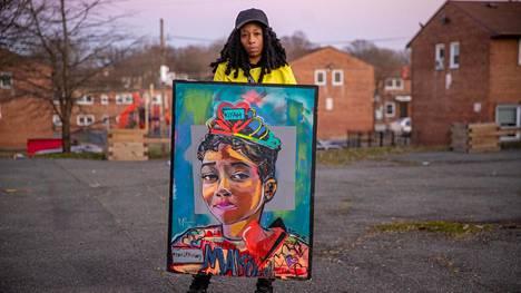 Donetta Wilsonin 10-vuotias tytär Makiyh menehtyi ampumisessa. Maalaus esittää Makiyahia.