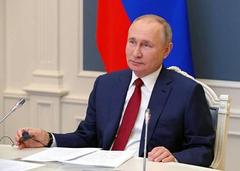 Venäjän presidentti Vladimir Putin puhui keskiviikkona Davosin talousfoorumissa videoyhteyden välityksellä.