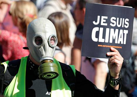 Mielenosoittajat vaativat päättäjiltä toimia ilmastokatastrofin torjumiseksi Pariisissa syyskuussa.