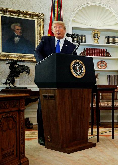 US President Donald Trump speaks next to a portrait of former President Andrew Jackson prior to awarding the Presidential Medal of Freedom to the US Olympic Gold Medalist Wrestler Dan Gable in the Oval Office at the White House in Washington, US, December 7, 2020.