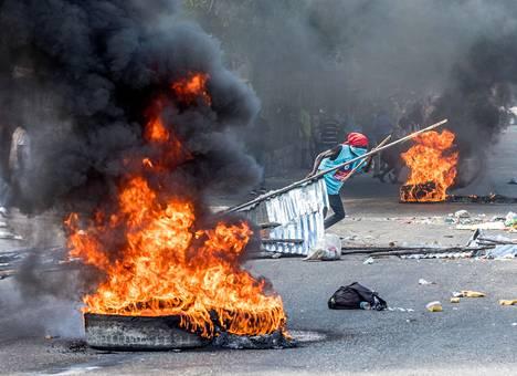 Presidentinvastaiset mielenosoittajat ovat vaatineet, että presidentti päättää kautensa sunnuntaina 7. helmikuuta. Kuva on otettu tammikuussa.