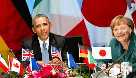 Yhdysvaltain presidentti Barack Obama ja Saksan liittokansleri Angela Merkel G7-kokouksessa maaliskuun 24. päivänä.