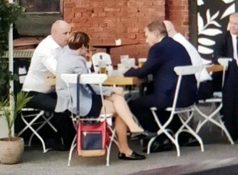 After the summit Finland's president Sauli Niinistö enjoyed a drink with his top aides around the corner from the Presidential Palace. Screen Capture from Jodel App.