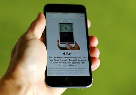 Apple Pay -kännykkämaksujärjestelmä iPhone 6 -puhelimen näytöllä.