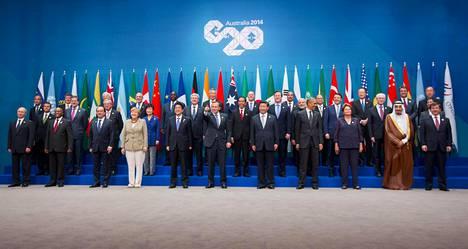 Venäjän presidentti Vladimir Putin joutui vuonna 2014 Brisbanen G20-huippukokouksen ryhmäkuvassa aivan vasempaan reunaan.