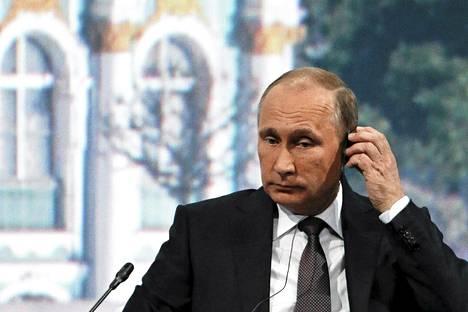 Venäjän presidentti Vladimir Putin Pietarin kansainvälisessä talousfoorumissa 19. kesäkuuta.