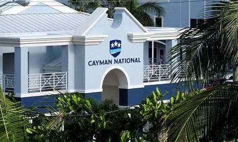 Useat Britannian merentakaisista alueista ovat tunnettuja veroparatiiseja. Nyt esimerkiksi Caymansaaret ovat lupautuneet antamaan automaattisesti tilitietoja.